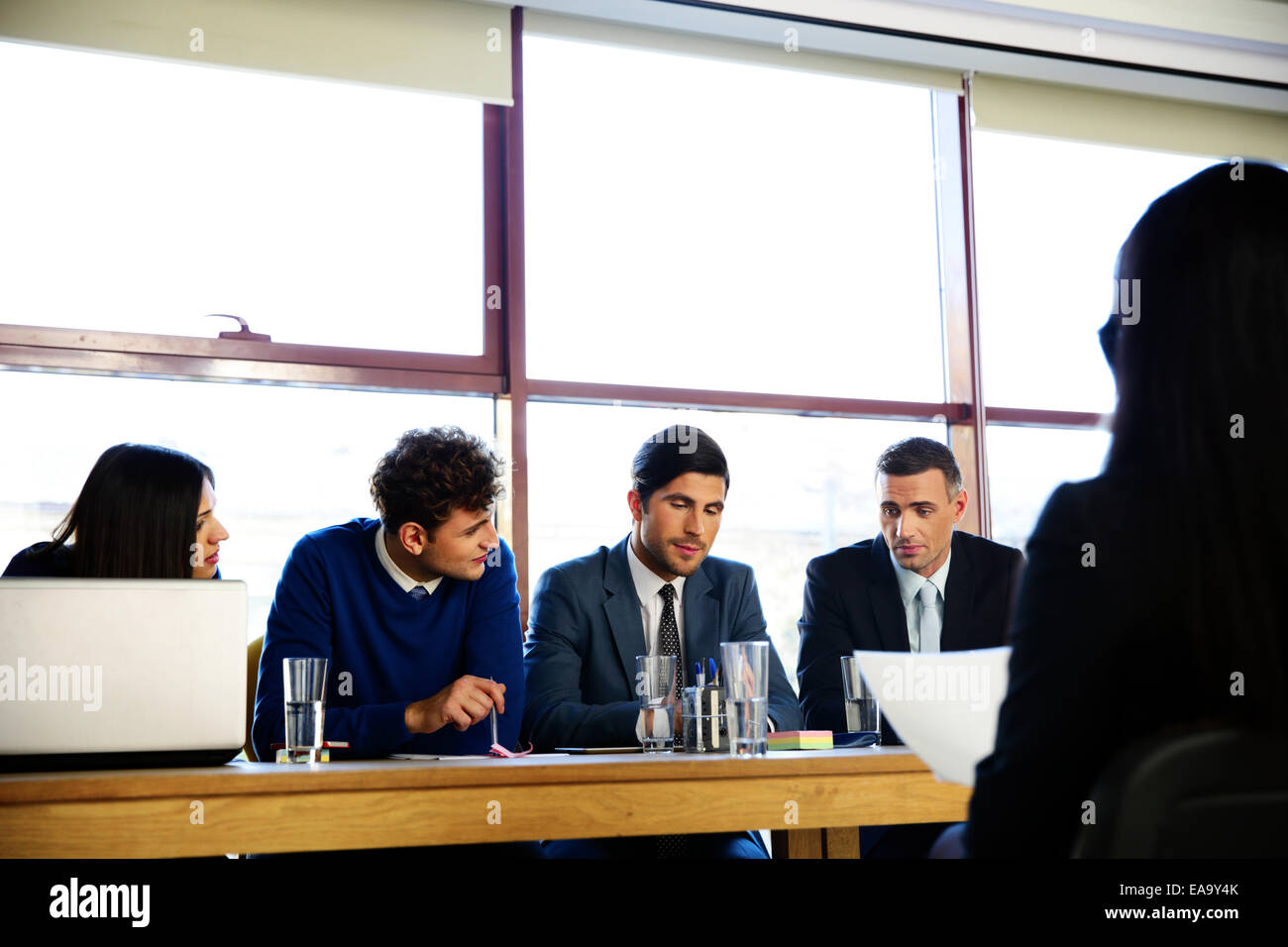 Woman sitting at interview in office - Stock Image