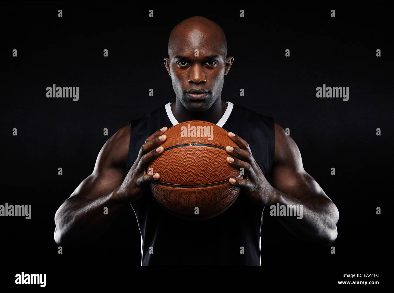 portrait of afro american male basketball player with a ball over