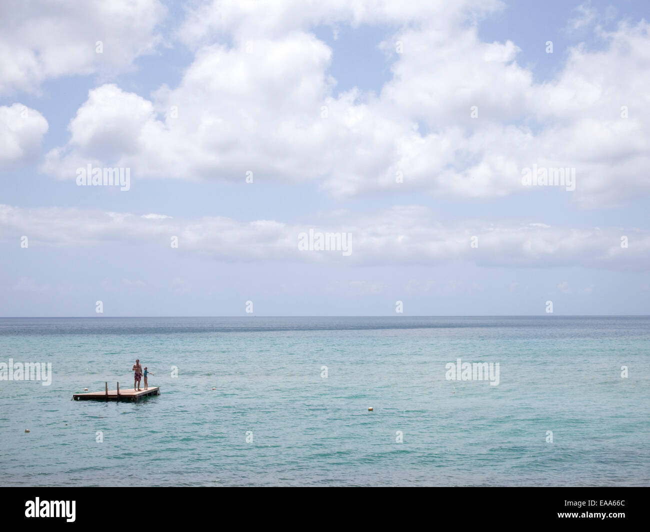 swimmers on raft in Caribbean Sea - Stock Image