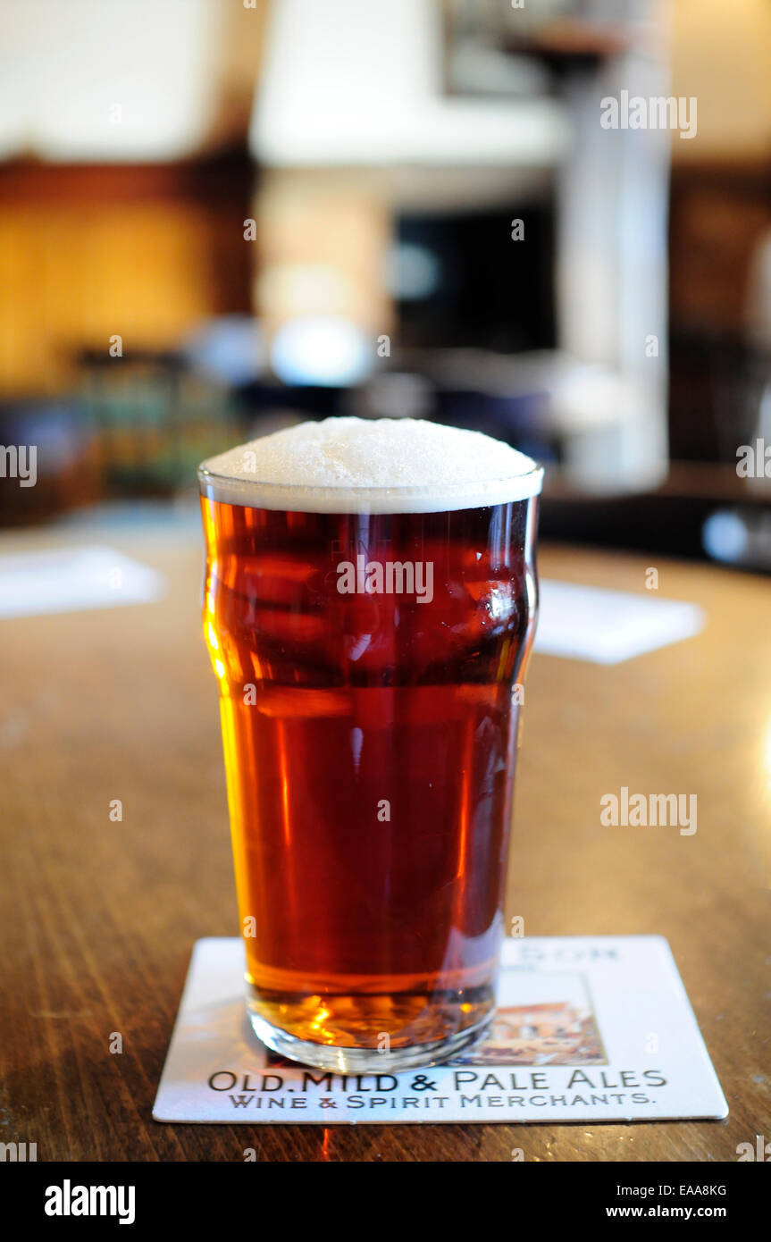 Pint of Harveys Best Bitter beer on a pub table Stock Photo