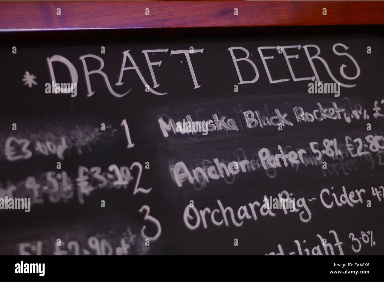 Chalkboard advertising draft beers in a pub - Stock Image