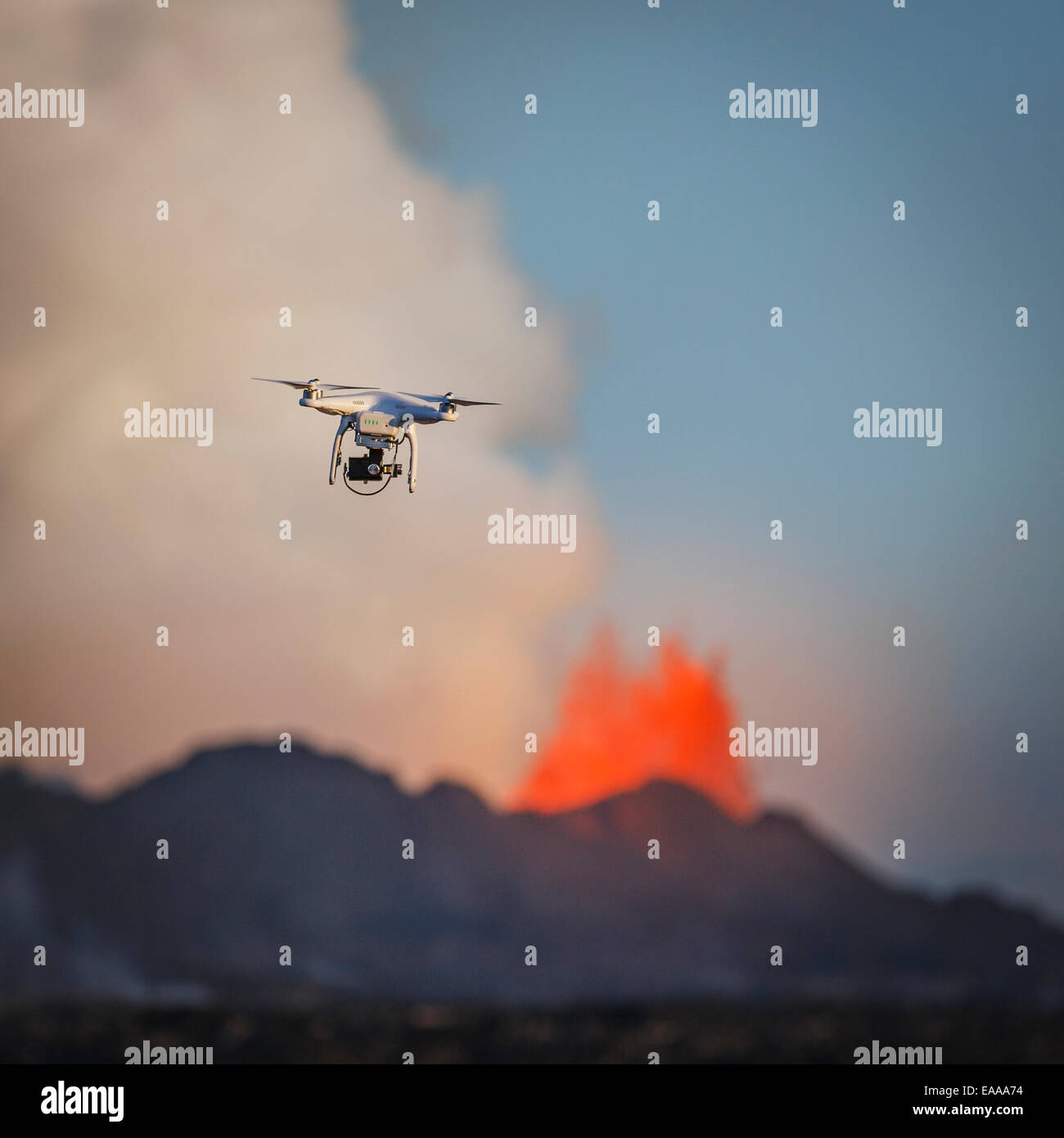 DJI Phantom 2 flying by the Holuhraun Fissure Eruption. Aerial view of lava and plumes. - Stock Image