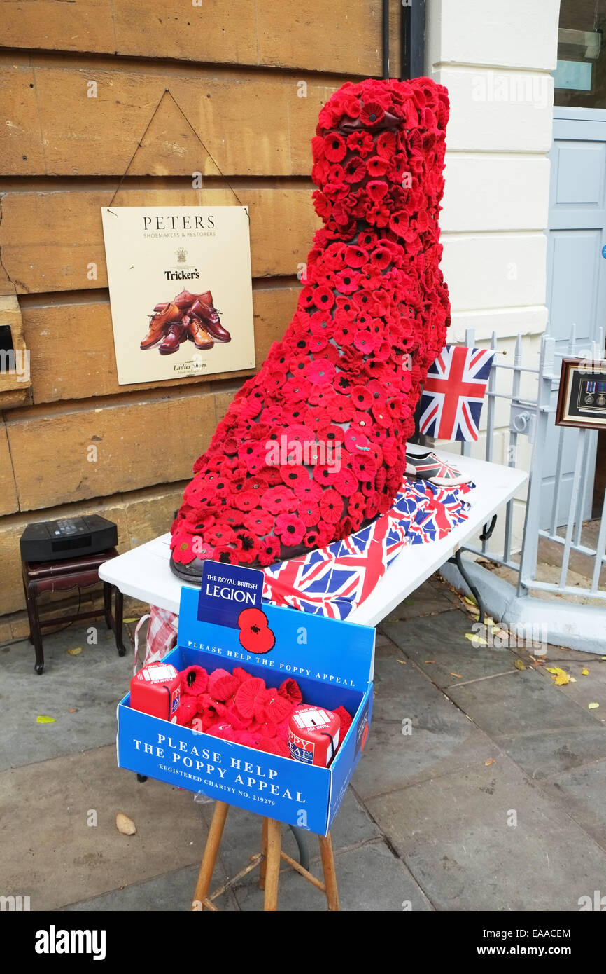 poppy day poppies for sale collection box display union jack flag royal british legion - Stock Image