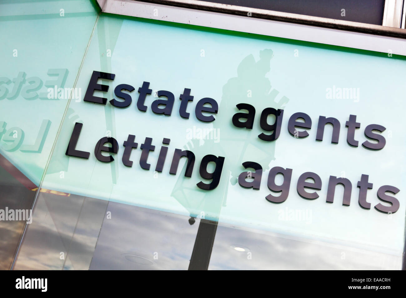 Estate agents agent letting sign words display shop store advertising - Stock Image