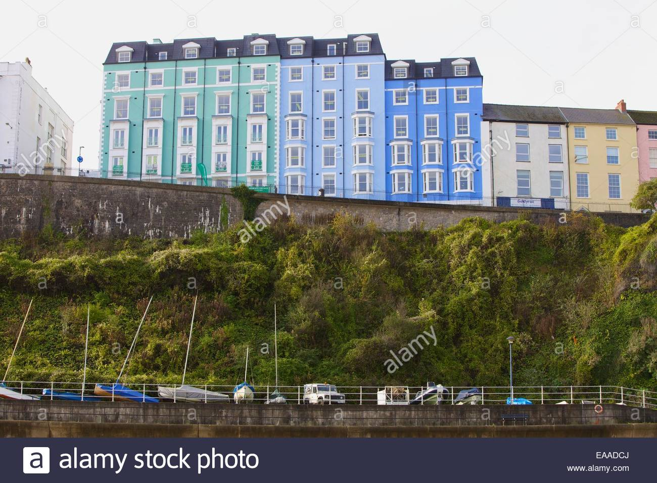 Houses above the quay Tenby Pembrokeshire South Wales - Stock Image