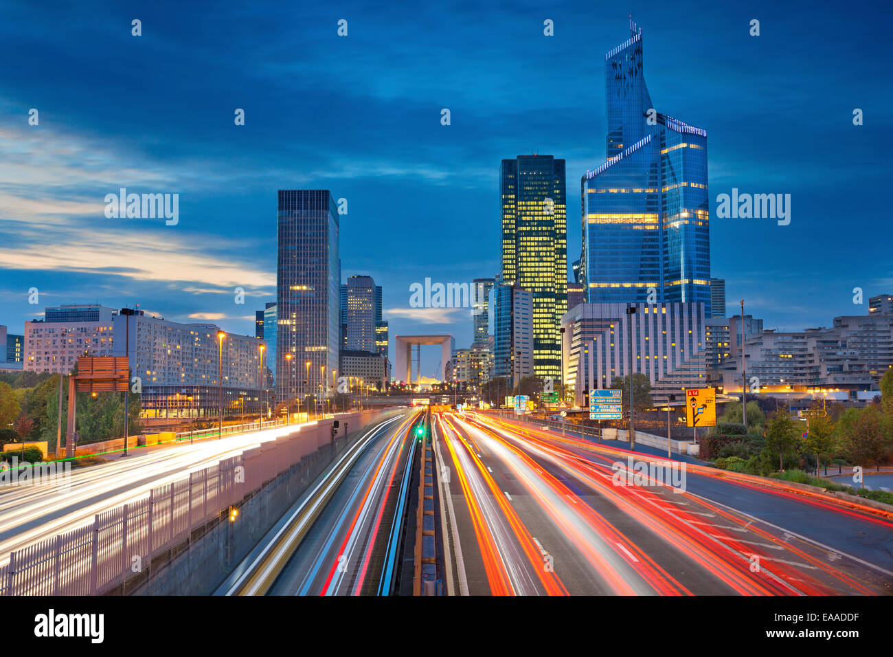 Image of office buildings in modern part of Paris- La Defense during twilight. - Stock Image