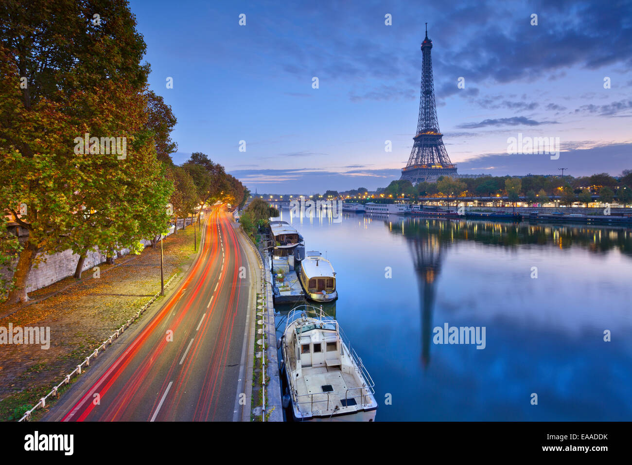 Image of Eiffel tower with the reflection in the Seine river. - Stock Image