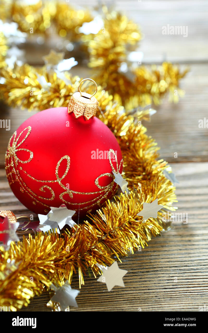 Christmas balls with tinsel on a wooden boards, holiday - Stock Image