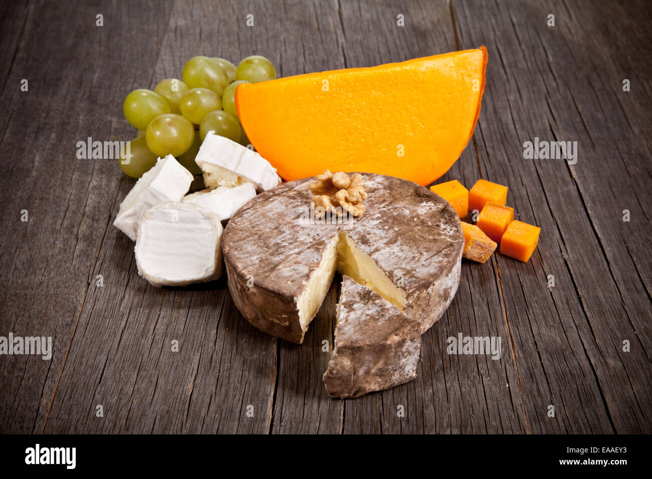 Delicious fresh french cheeses served on wooden table Stock Photo