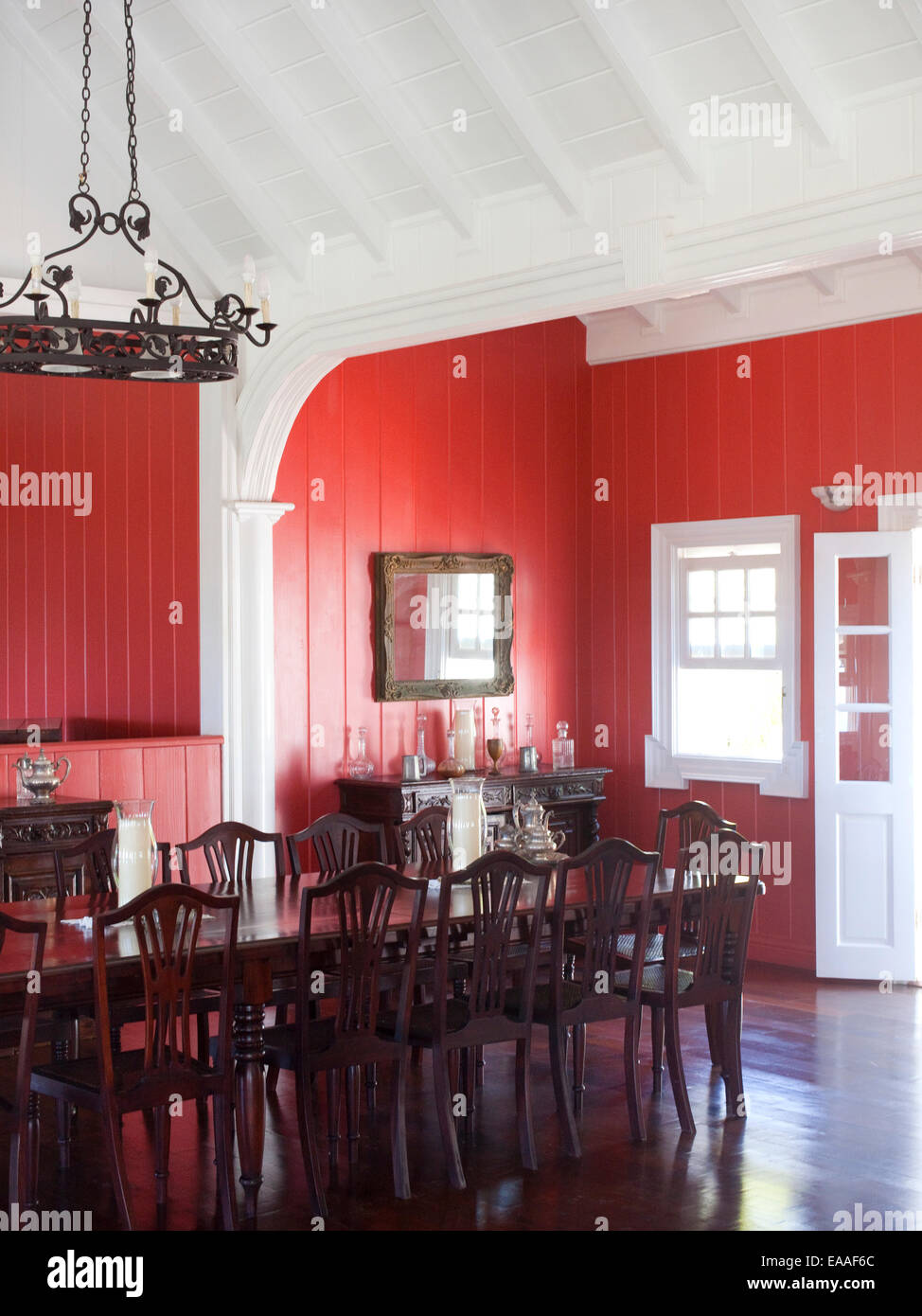 Dining room and dining table and chairs in colonial style Caribbean home - Stock Image
