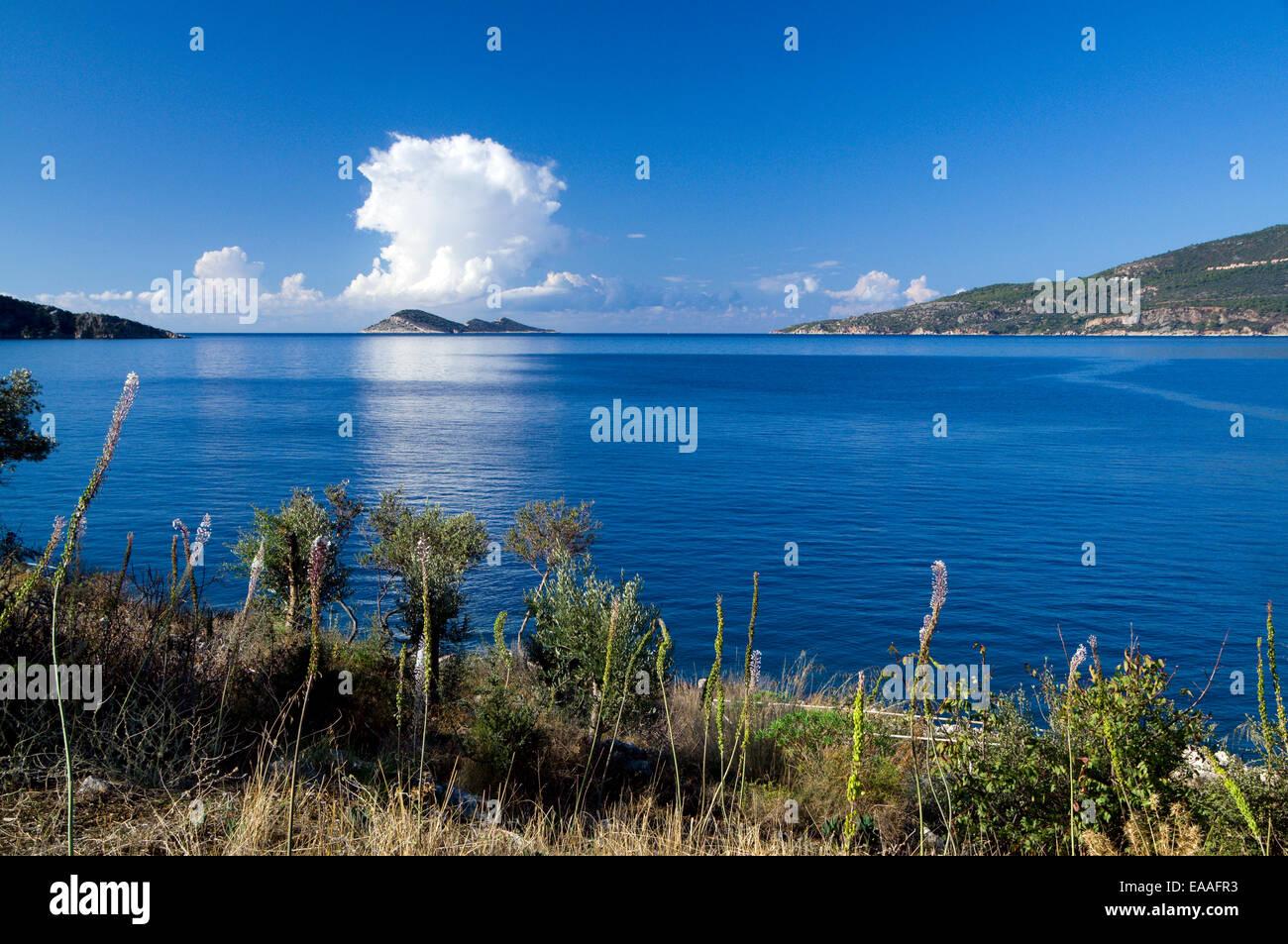 Cumulonimbus clouds aove Snake and Mouse Islands, Kalkan Bay, Kalkan, Lycian Coast, Turkey, Asia. - Stock Image