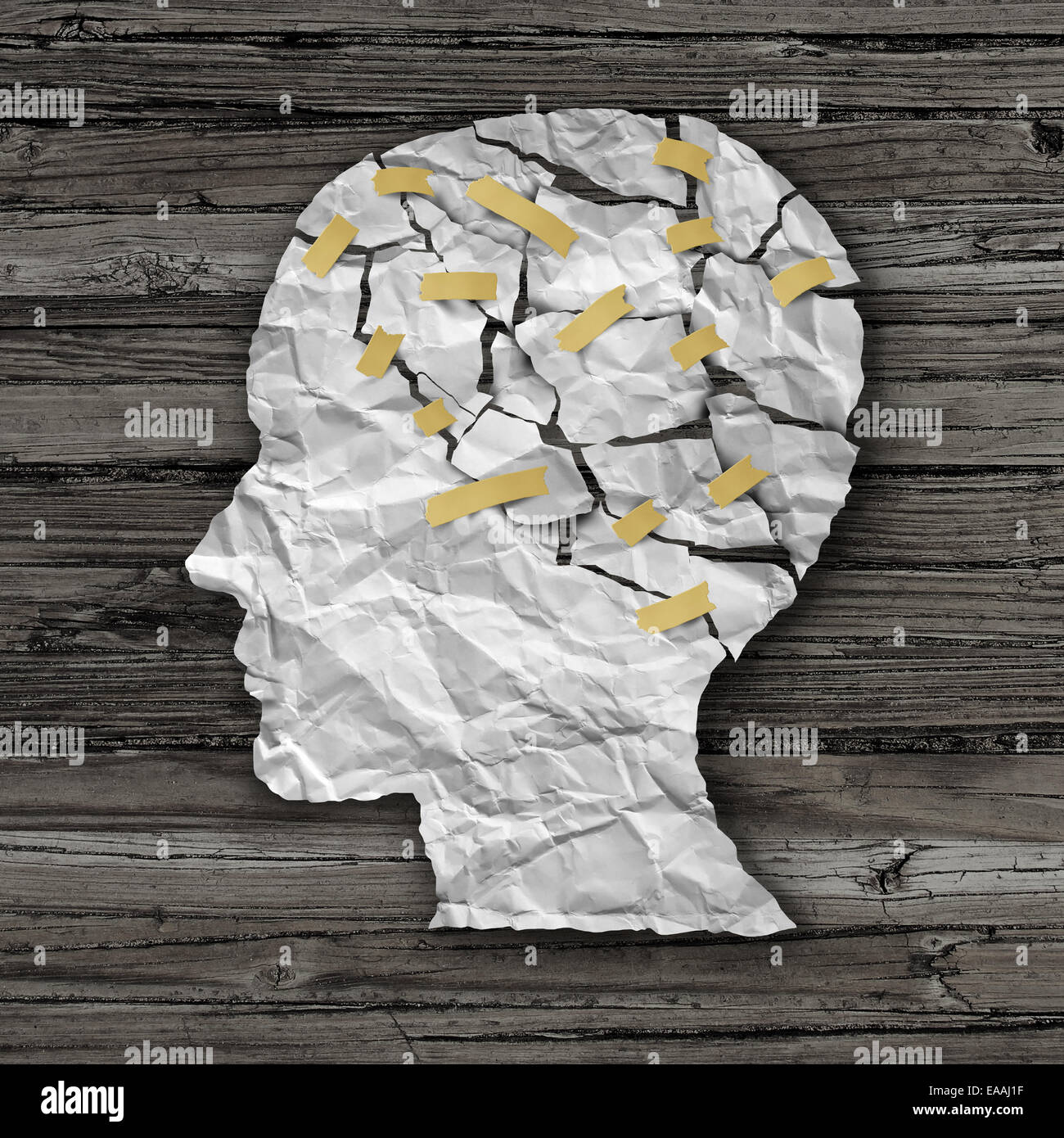 Brain disease therapy and mental health treatment concept as a sheet of torn crumpled white paper taped together - Stock Image