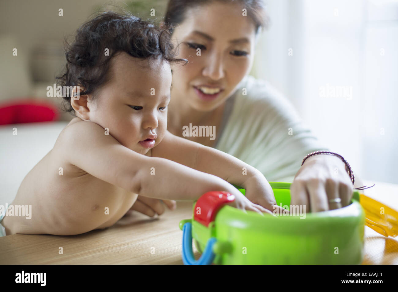 Mother playing with her baby boy. - Stock Image