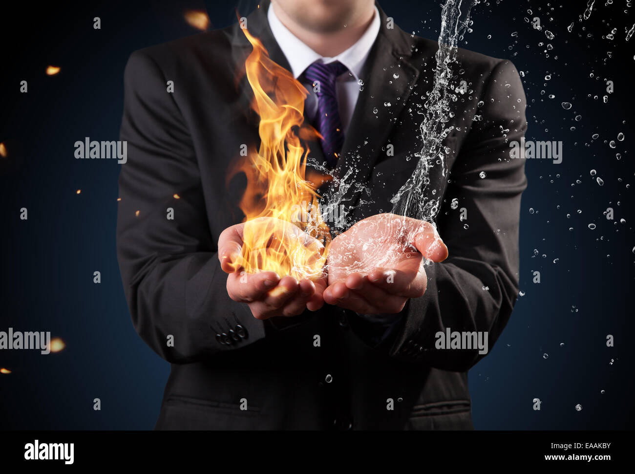 Businessman with fire and water in hands. Concept of threats and solutions as so as manager responsibility and power - Stock Image