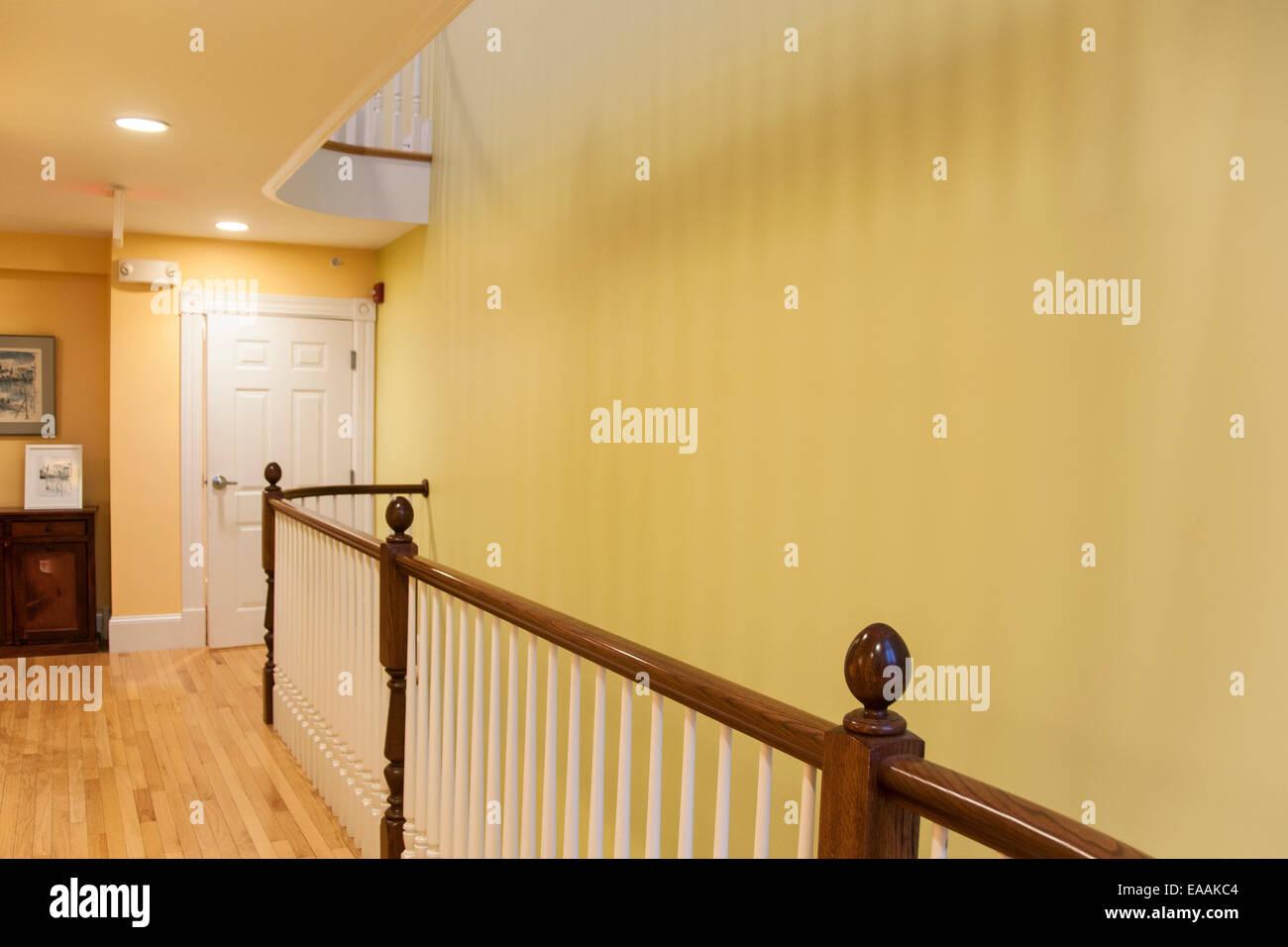 yellow hallway wood floors white bannisters stock photo 75222788