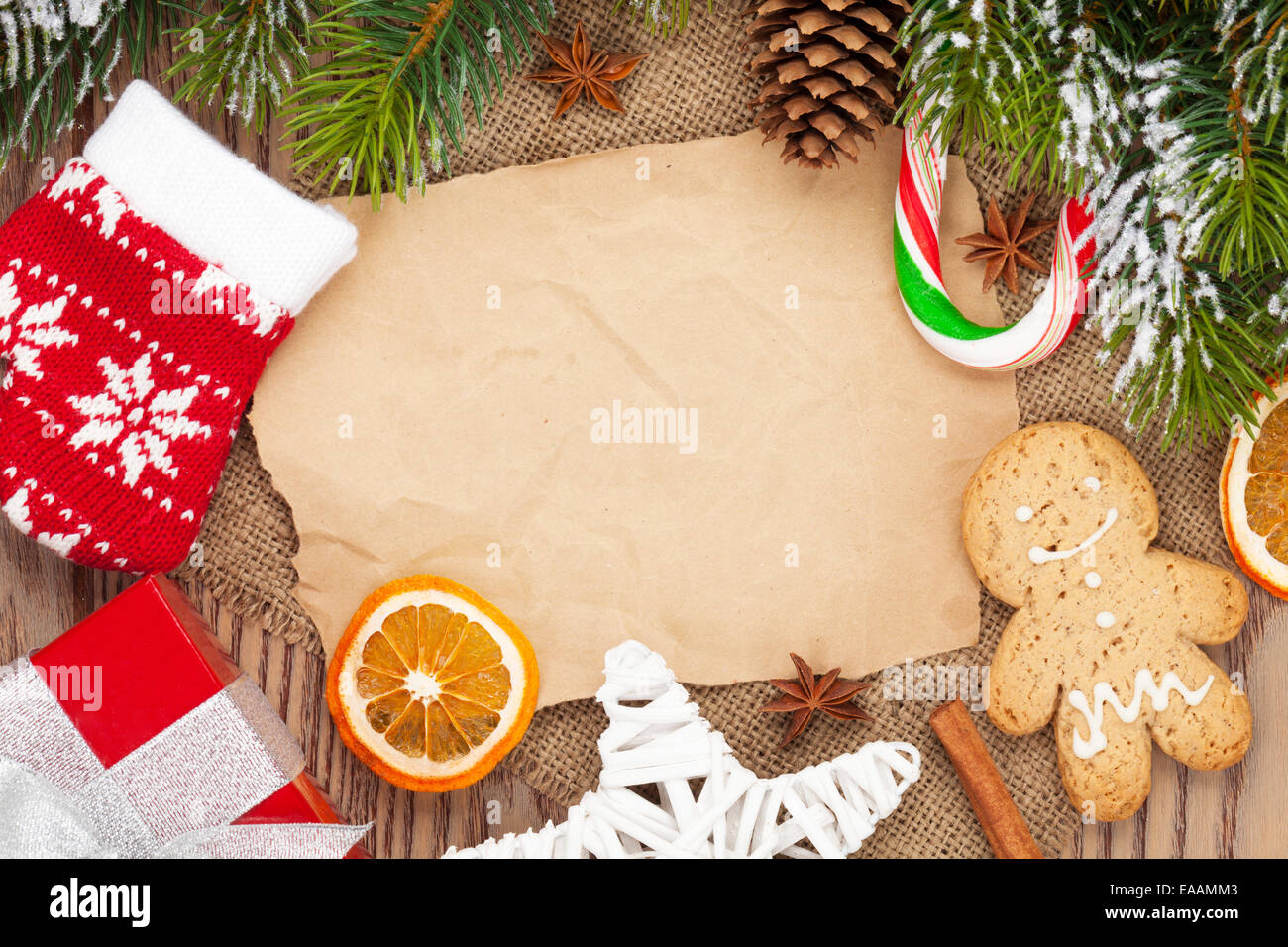 Christmas food and decor with snow fir tree background with paper for copy space - Stock Image