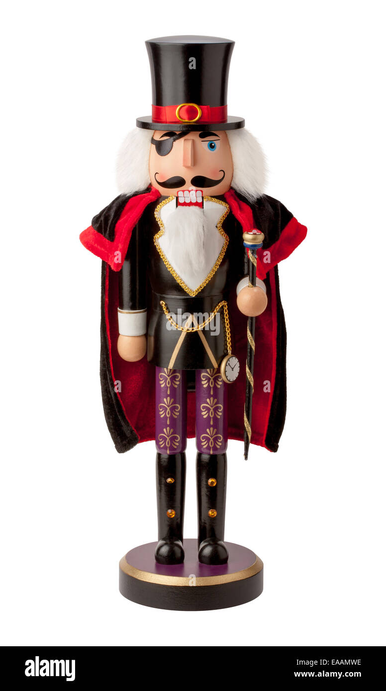 Vintage wooden aristocrat nutcracker with a top hat and cape. - Stock Image