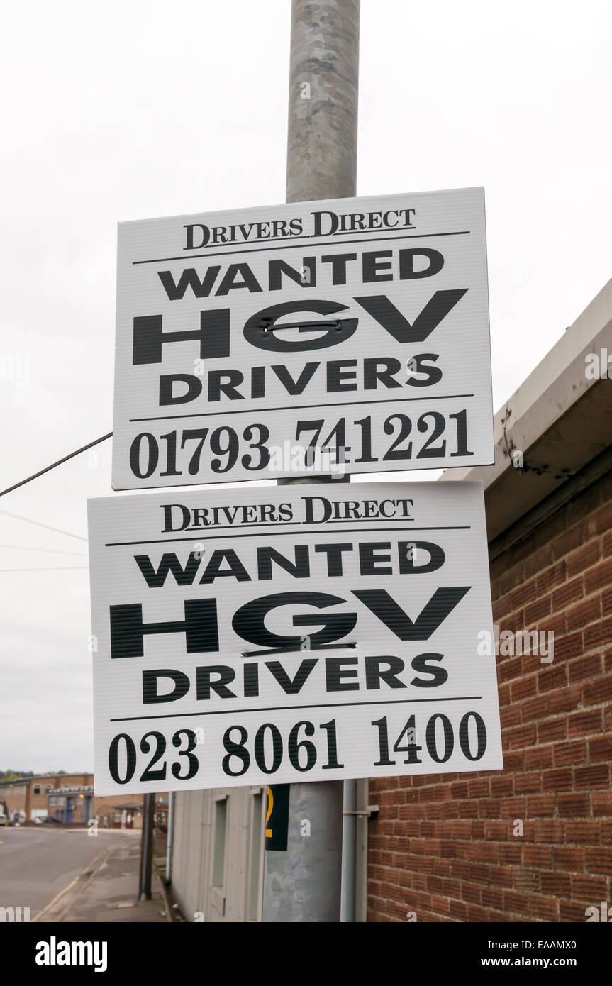 Signs attached to metal post advertising for HGV drivers wanted UK - Stock Image