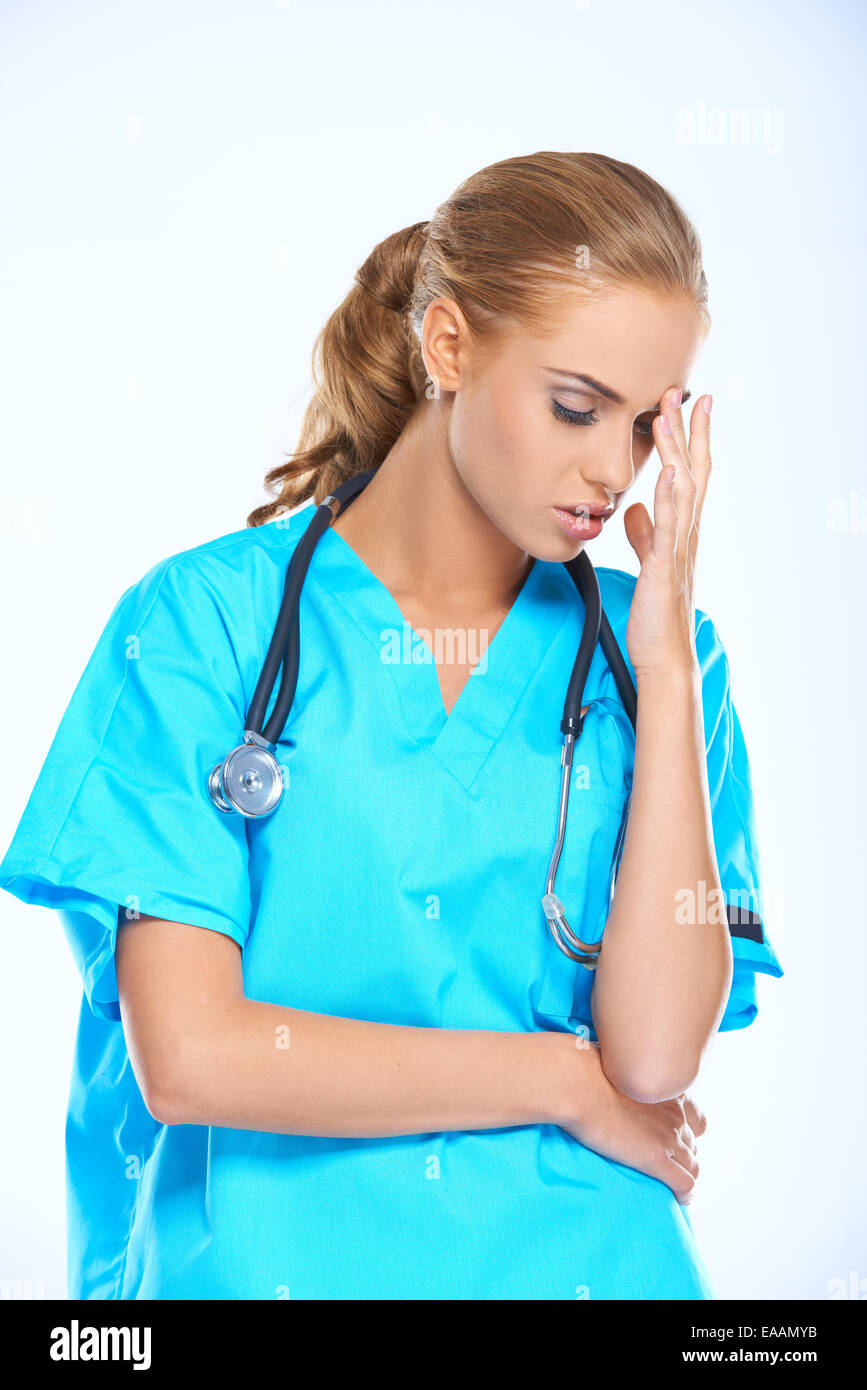 Stressed nurse or doctor with a headache - Stock Image