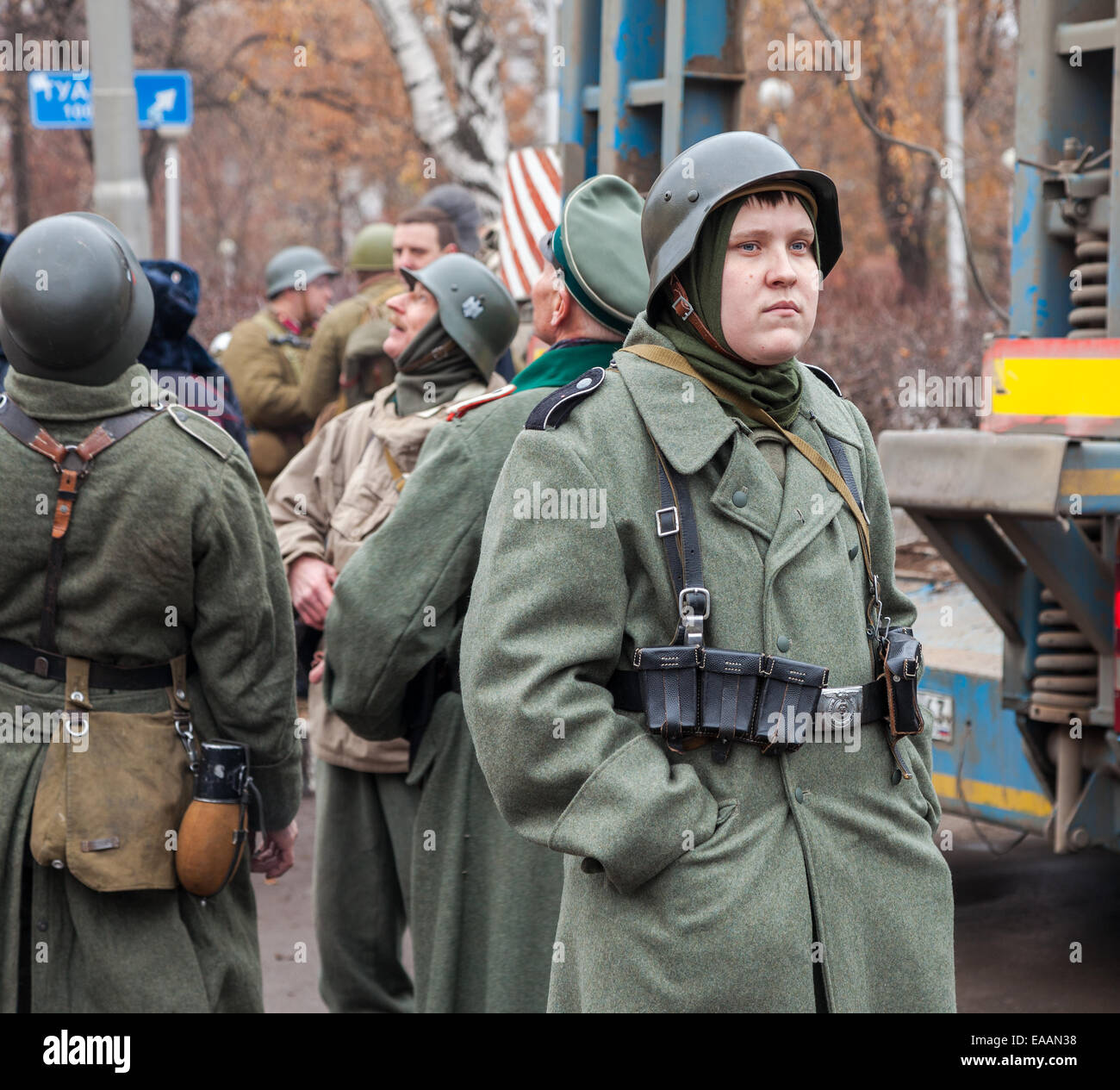 Member of Historical reenactment in German Army uniform after battle - Stock Image