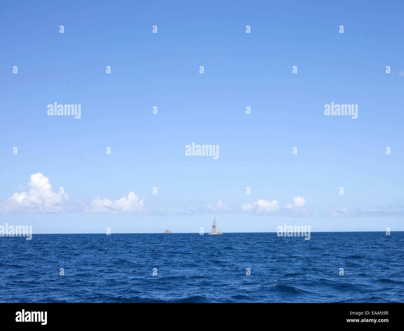 Booby Island and sail boat between St. Kitts and Nevis - Stock Image