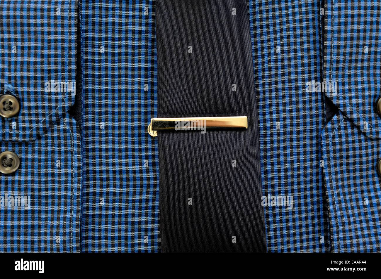 A blue business shirt and tie with a tie clip Stock Photo