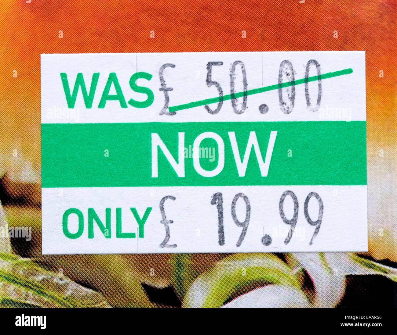 A was now pricing label showing a reduction of £50 to £19.99 - Stock Image