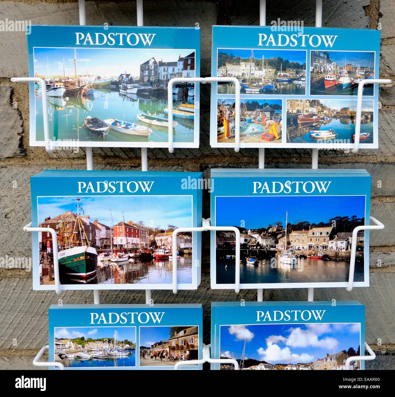 Souvenir postcards on sale outside a shop in Padstow Cornwall England uk - Stock Image