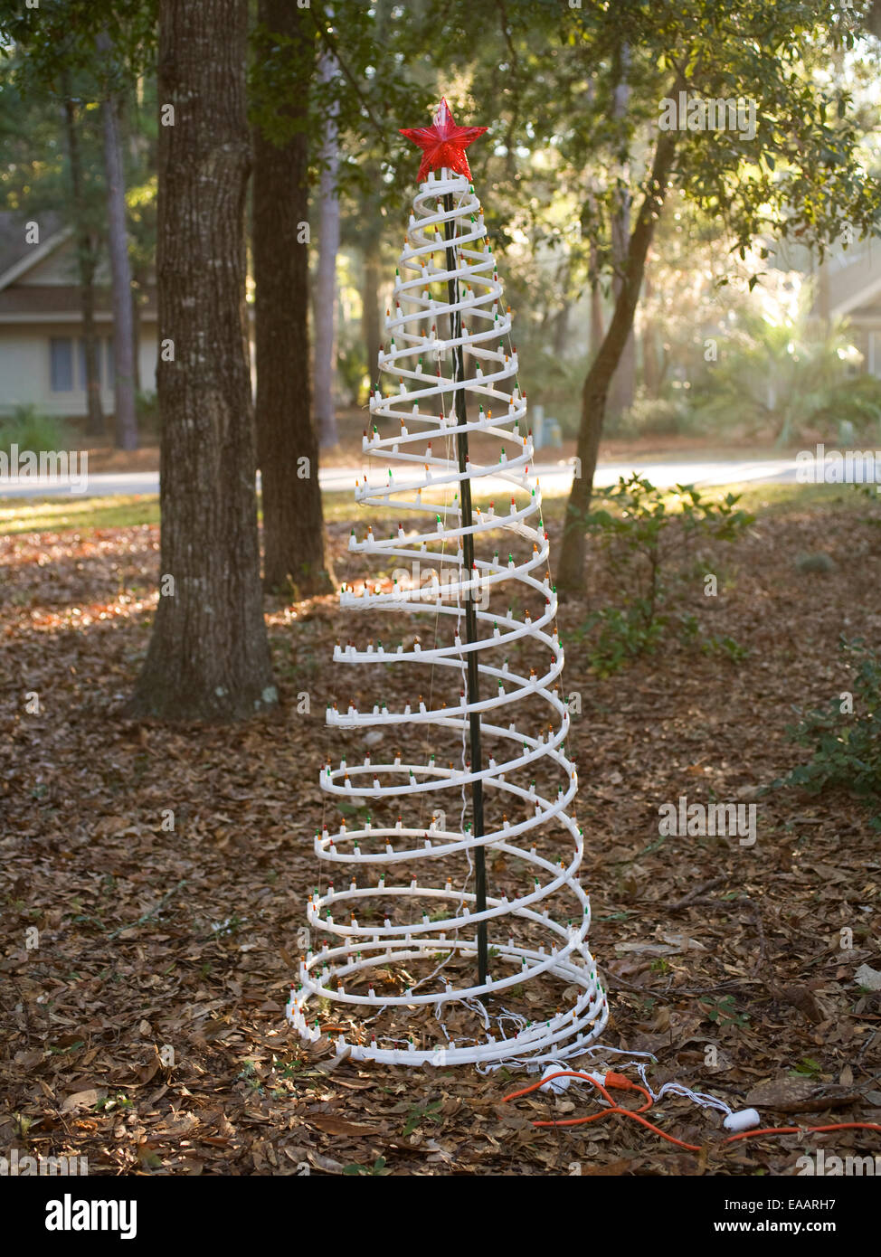 Fake Christmas tree in yard in the South - Stock Image