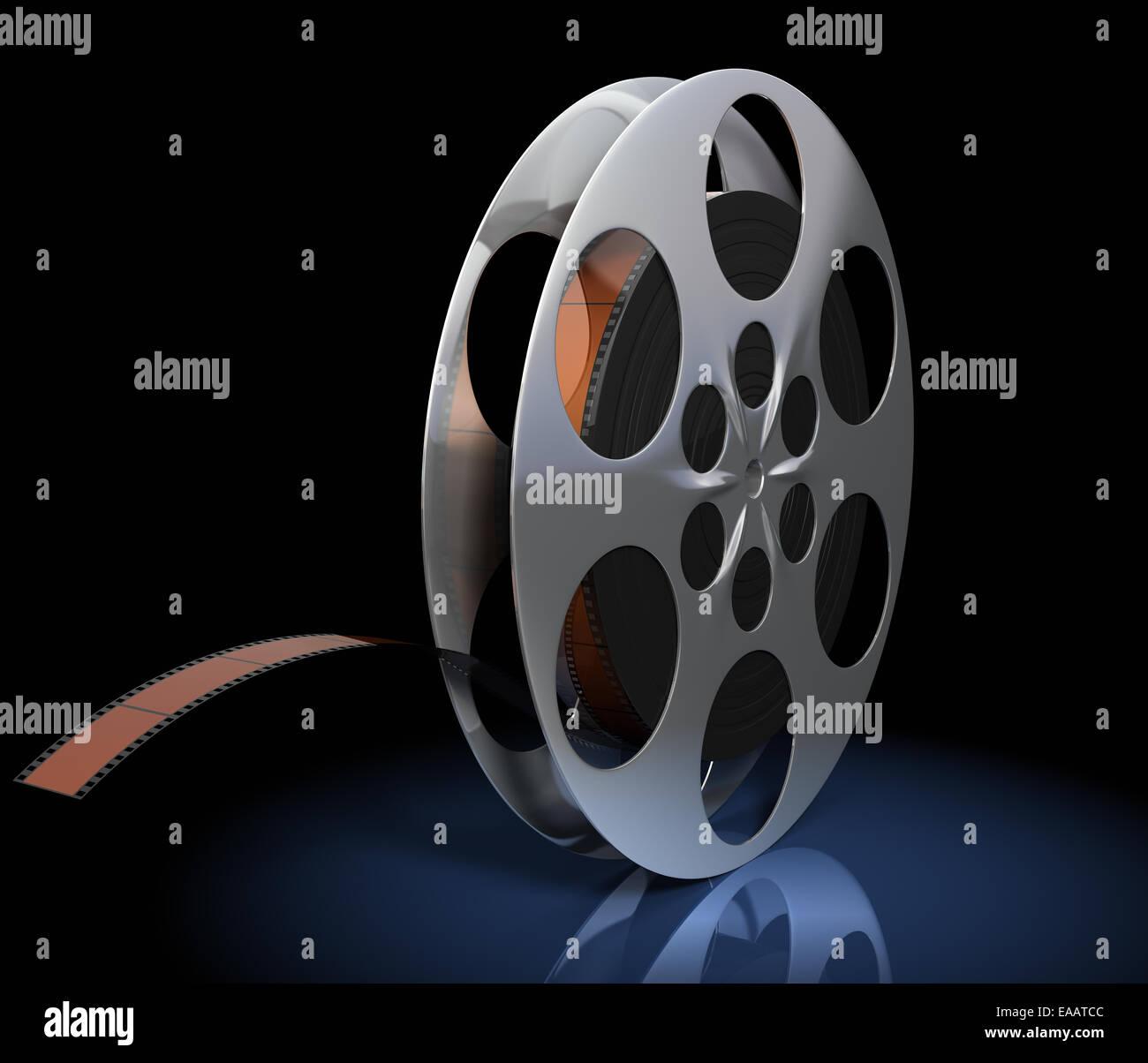 Film reel on black background - Stock Image