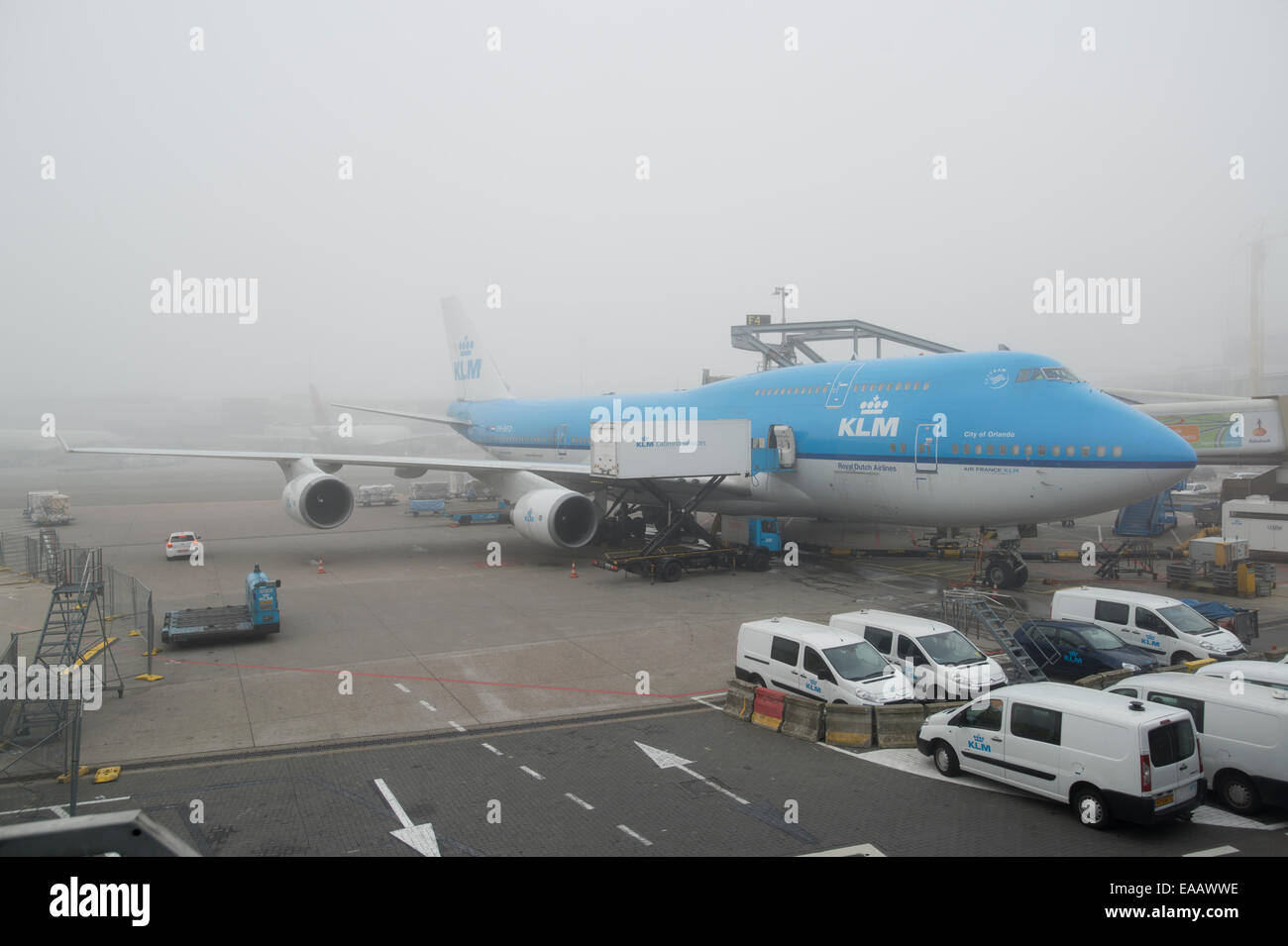 Fog delays a KLM Boeing 747 airliner from taking off at Amsterdam Schiphol Airport (Editorial use only). - Stock Image
