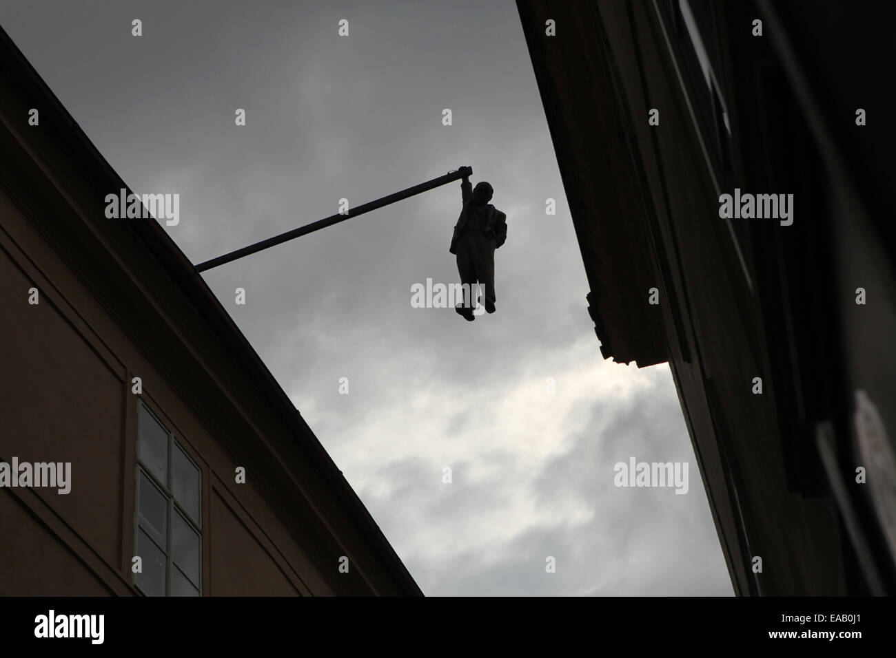 Statue entitled 'Hanging Out' by Czech controversial visual artist David Cerny in Husova Street in Prague, - Stock Image