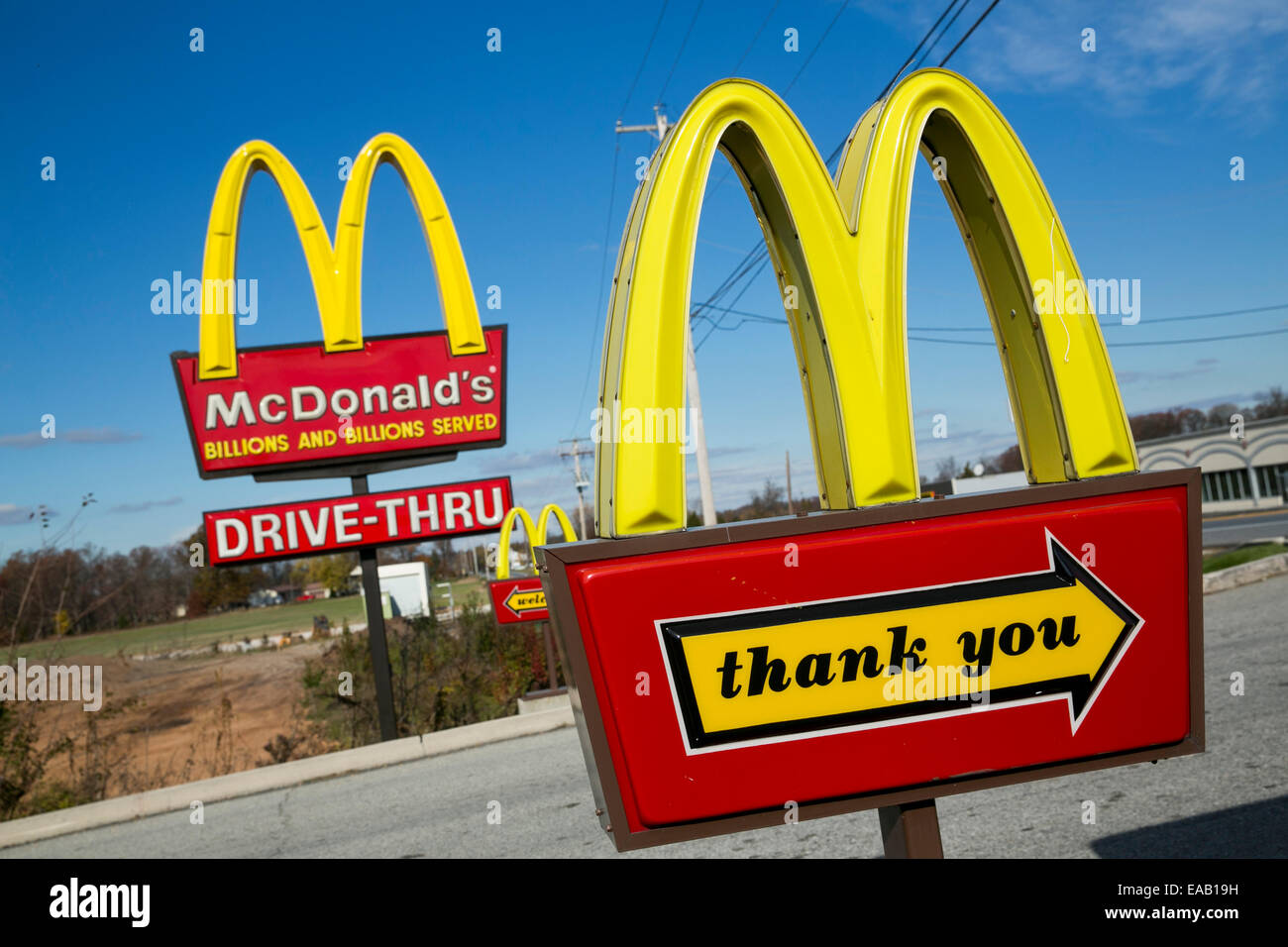 multiple mcdonald s golden arches fast food restaurant signs stock