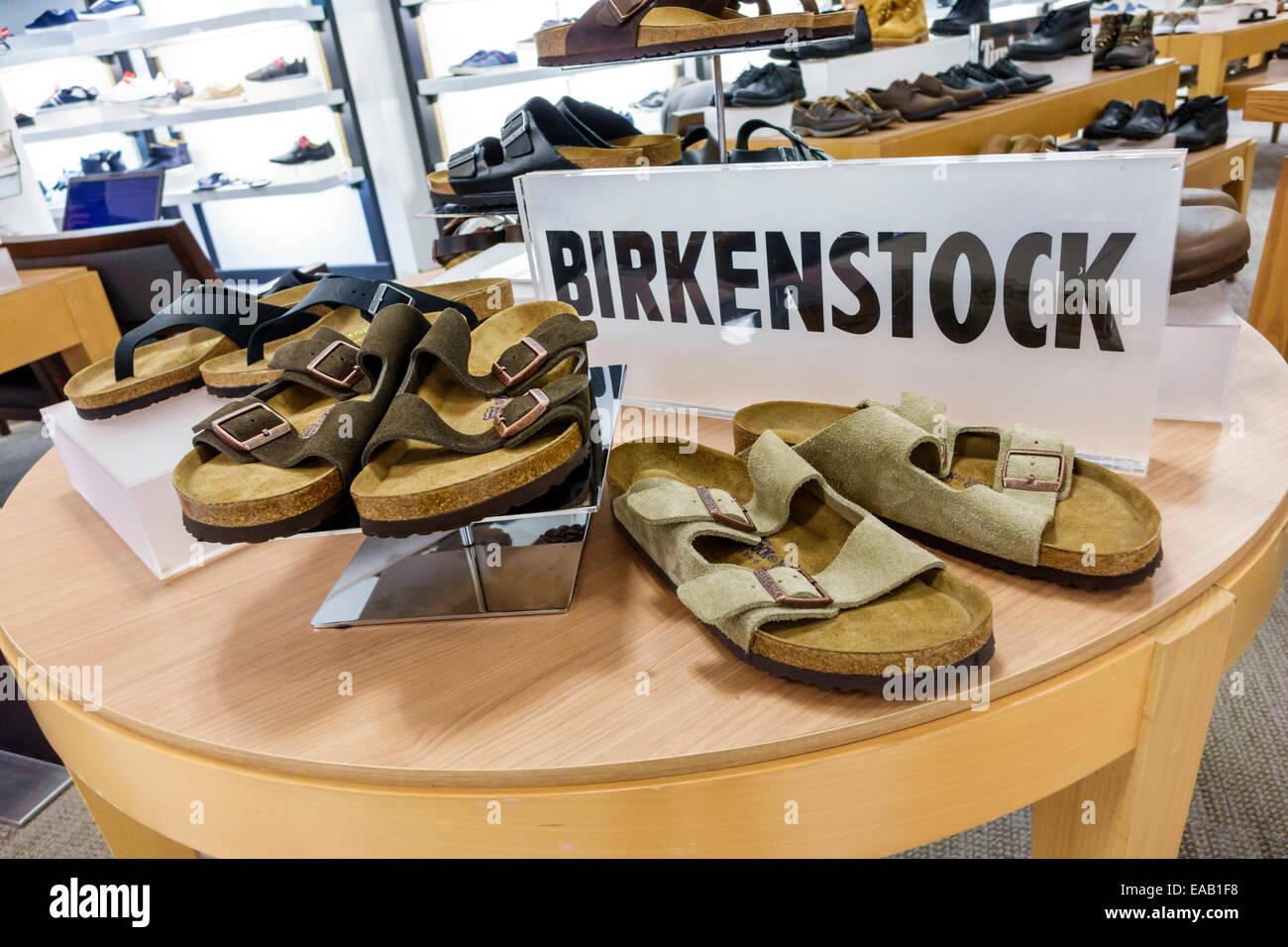 Miami Florida Macy's department store shopping inside sale display sandals fashion Birkenstock men's - Stock Image