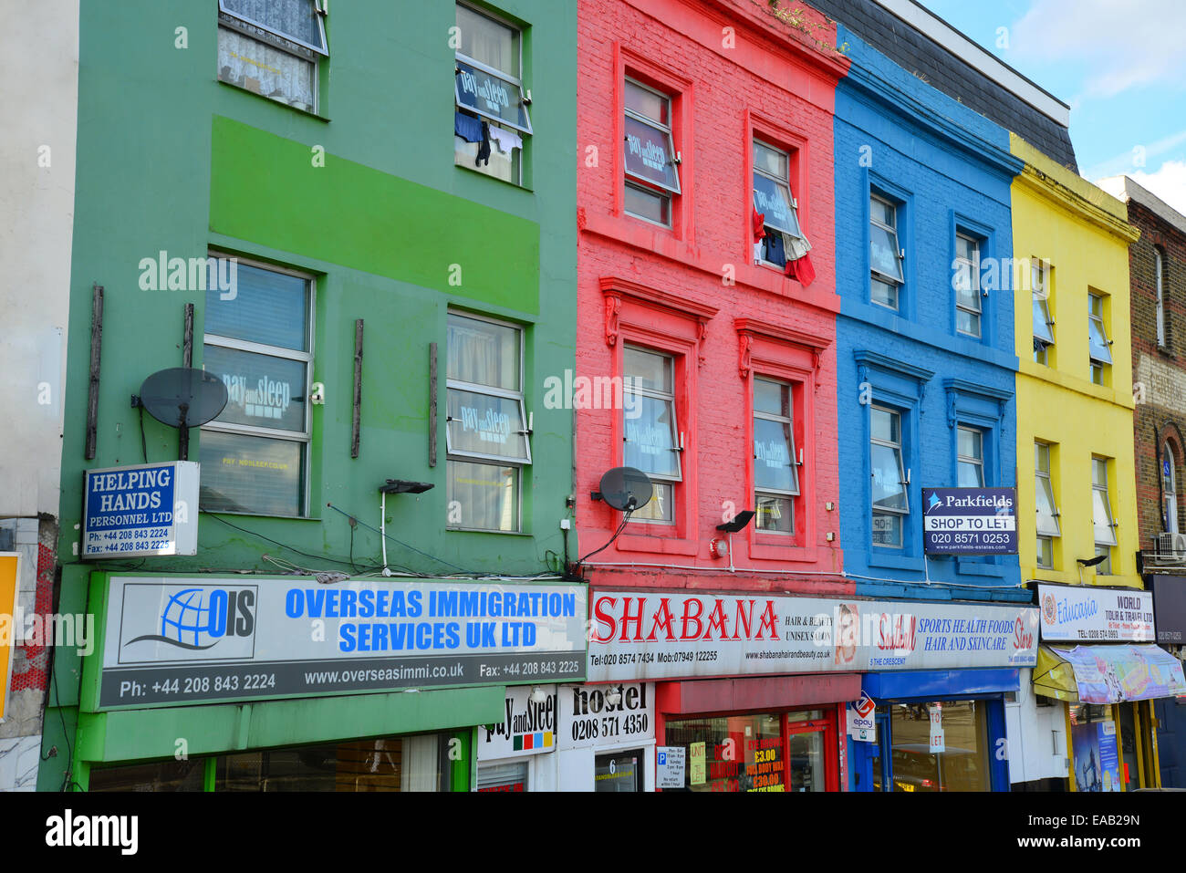 Colourful shopfronts, The Crescent, Southall, London Borough of Ealing, Greater London, England, United Kingdom - Stock Image