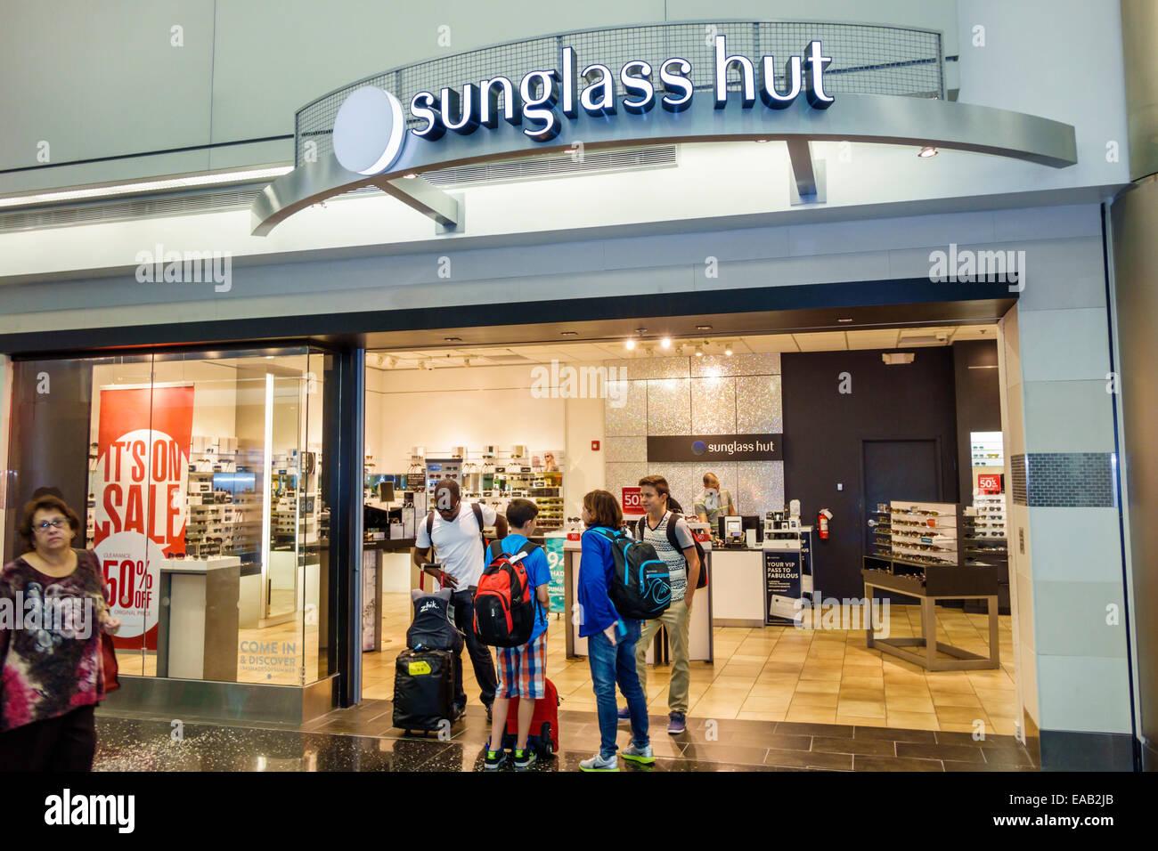 54837940901 MiamiMiami Florida International Airport MIA terminal concourse gate area  shopping front entrance sunglass hut store business sunglasses