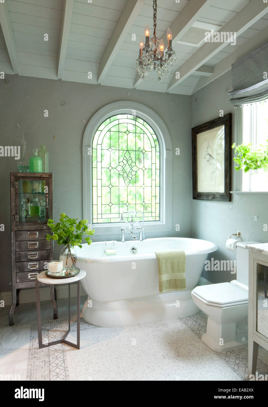 Contemporary bathroom with large window and ceramic tub. - Stock Image