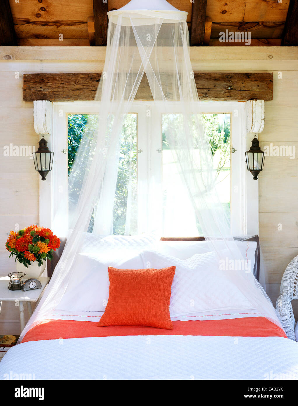 well made bed with bug netting - Stock Image