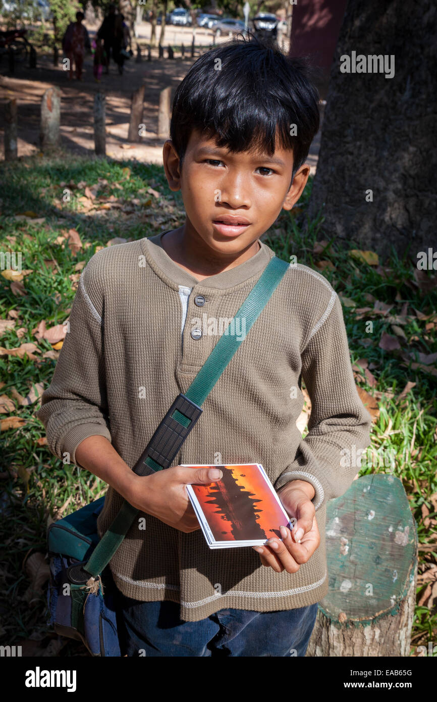 Cambodia.  Young Boy Selling Postcards of Angkor wat. - Stock Image