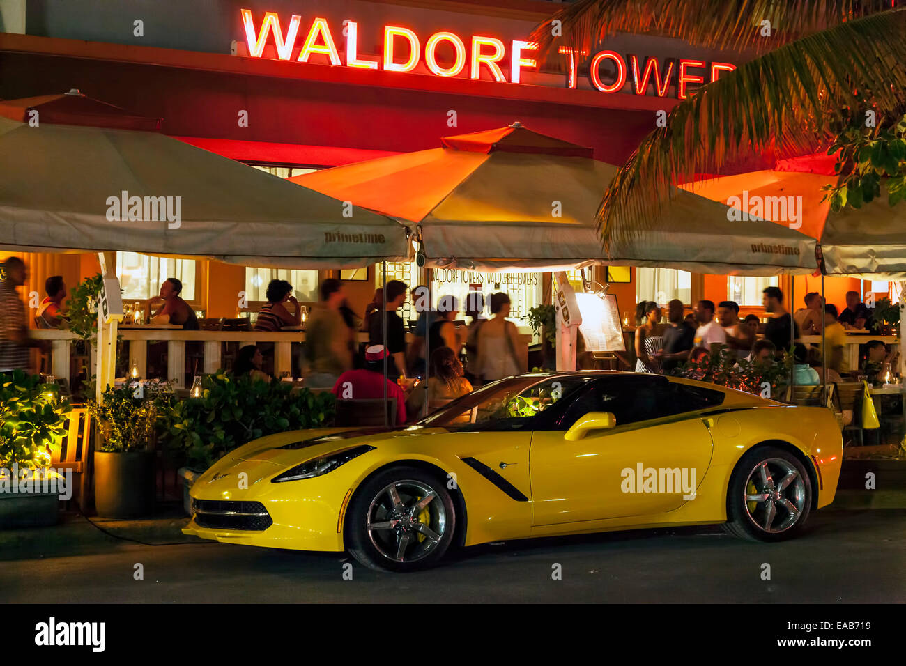 Bright yellow 2014 Chevy Corvette parked in front of the Room Mate Waldorf Towers on Deco Drive, Miami South Beach, Stock Photo