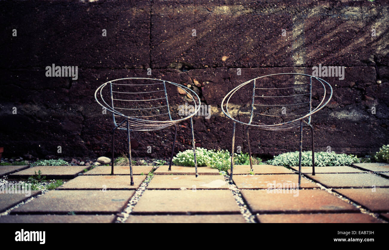 Two patio chairs without cushions steel framed - Stock Image