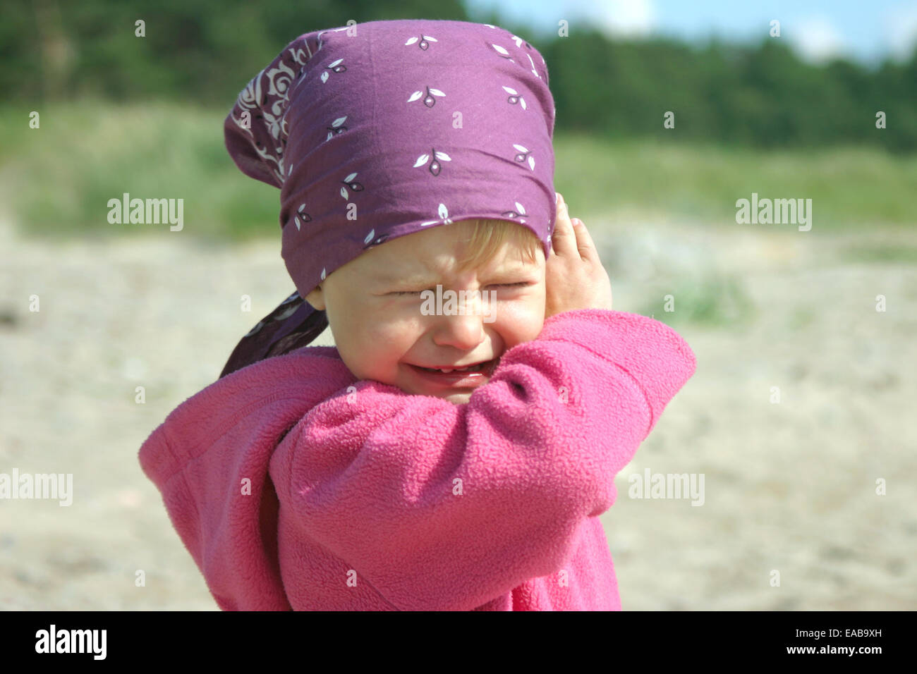 Portrait of angry and crying 2-3 years old girl - Stock Image