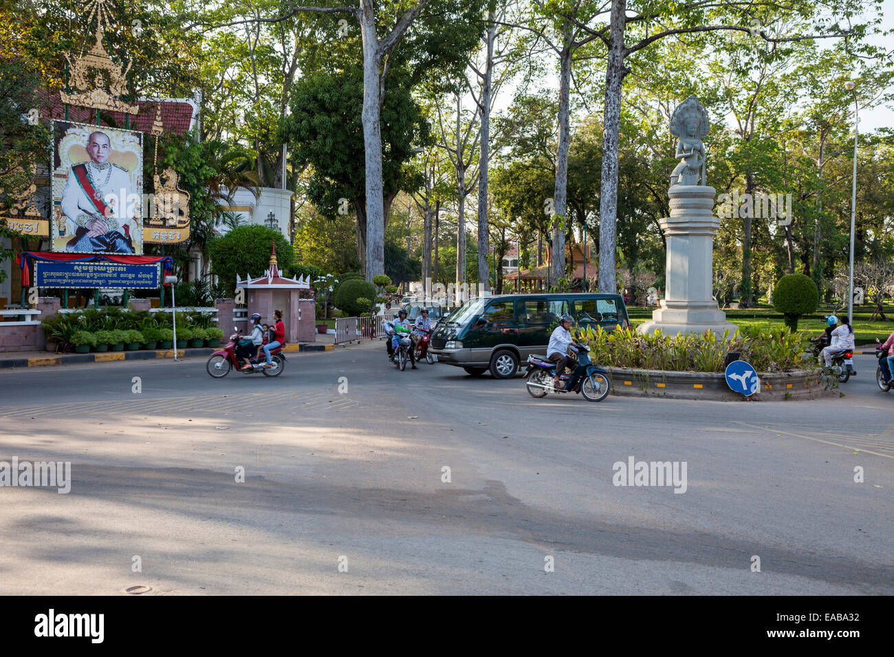 Cambodia, Siem Reap.  Street Traffic, with Poster in Honor of Former King Norodom Sihanouk. Stock Photo