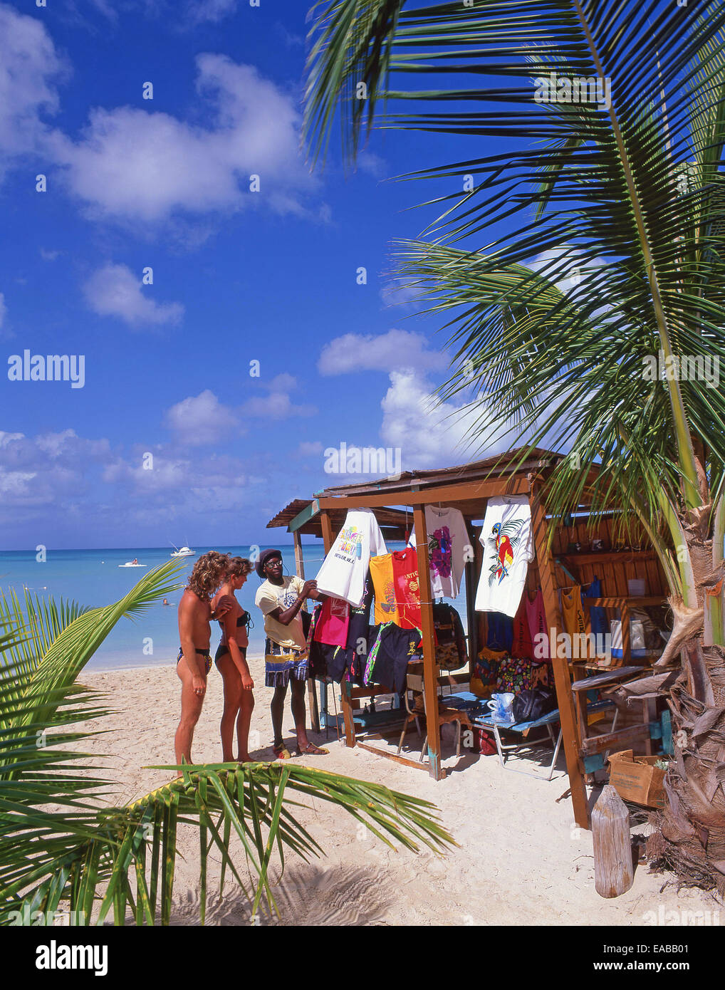 Couple at beach stall, Jolly Beach, Saint Mary's Parish, Antigua, Antigua and Barbuda, Lesser Antilles, Caribbean - Stock Image