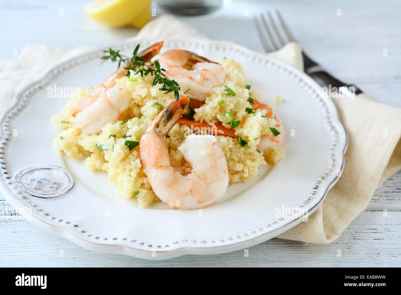 Tasty couscous with shrimp, nutritious food - Stock Image