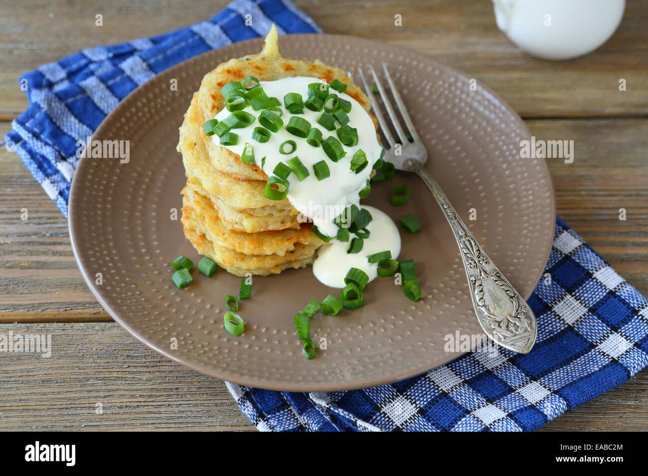 Stack of Potato pancakes on a plate, on napkin - Stock Image
