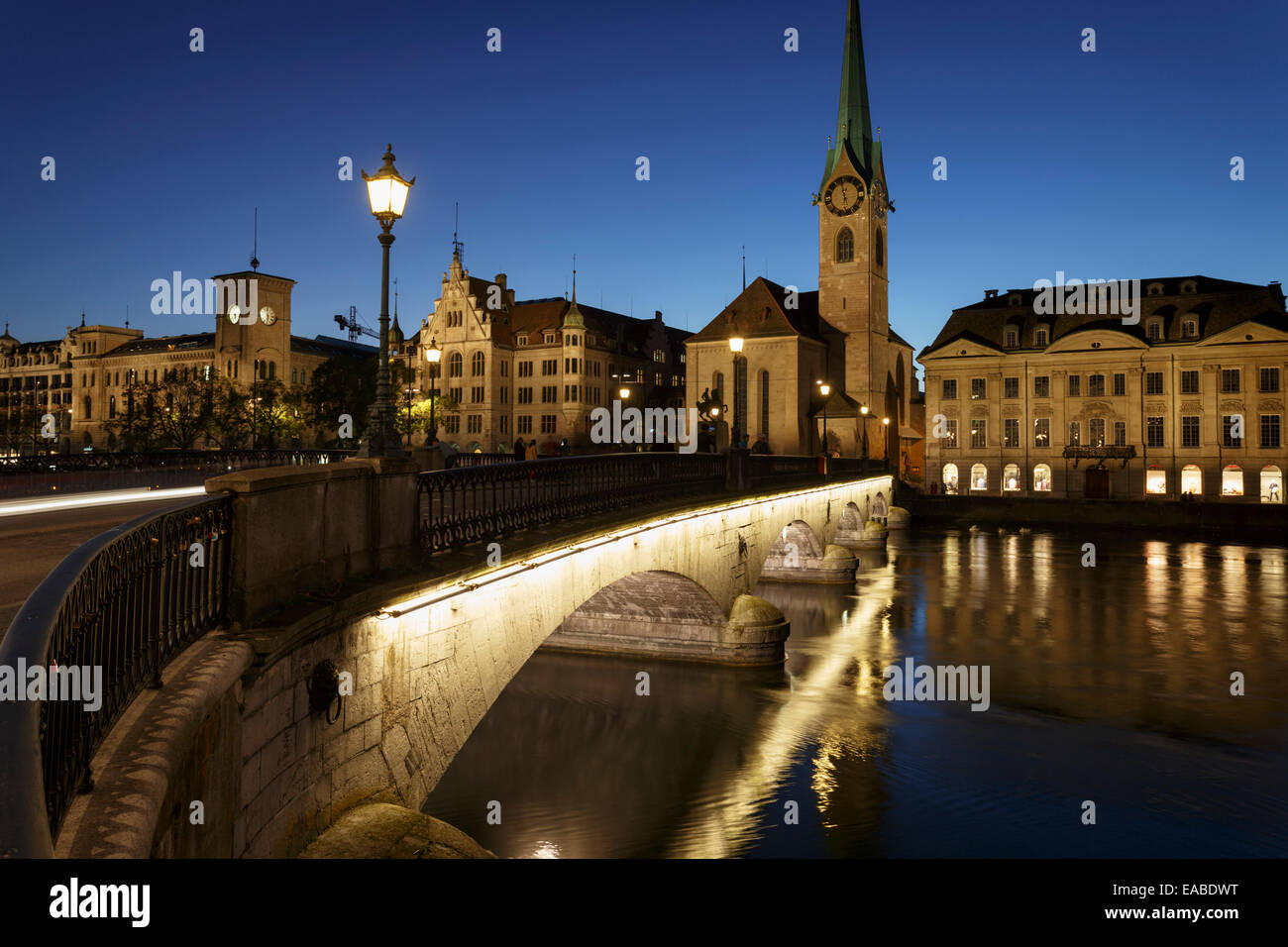 Zurich at night with Fraumunster church, Munsterbrucke and river Limmat, Switzerland - Stock Image