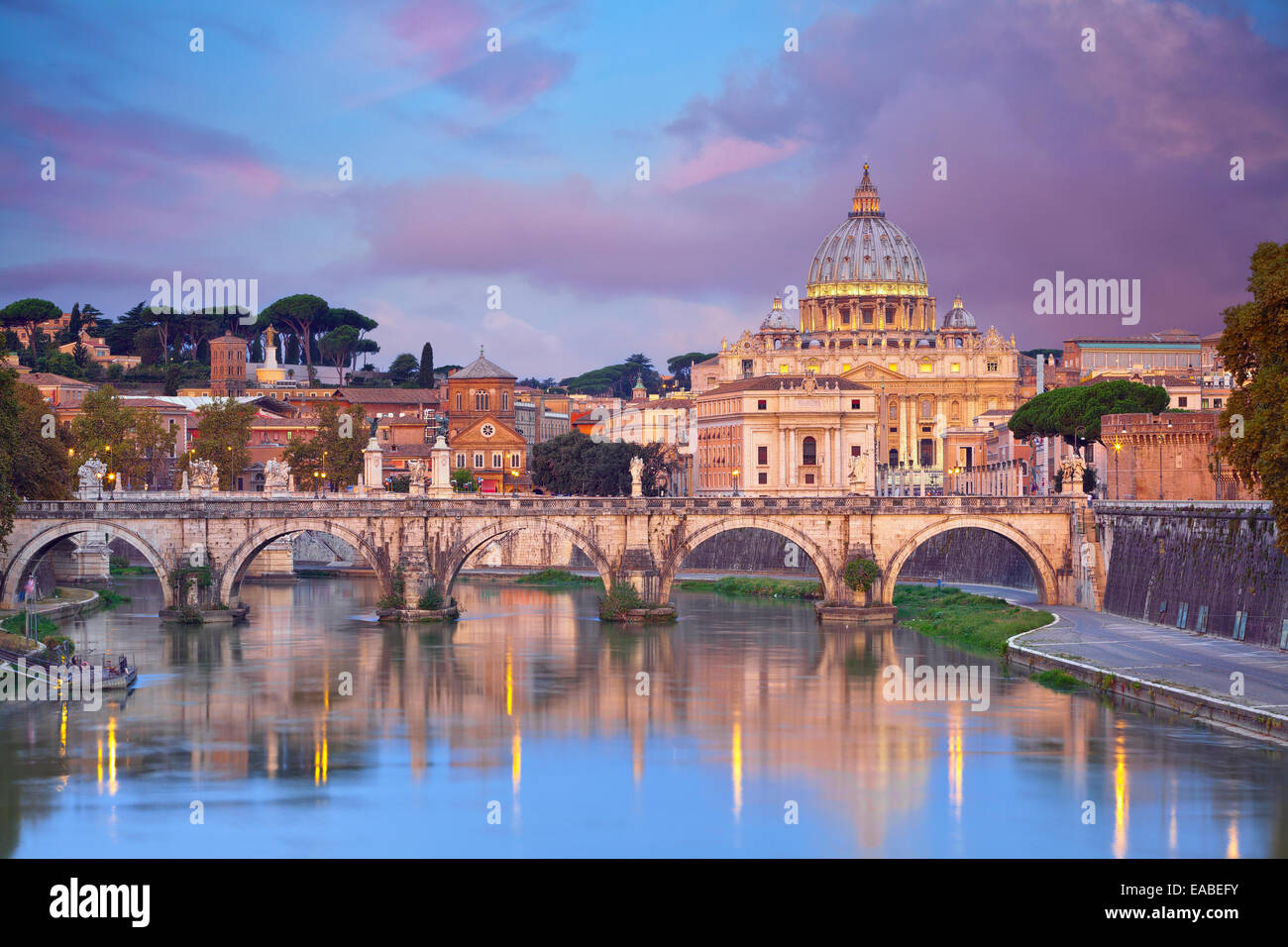 Rome. View of Vittorio Emanuele Bridge and the St. Peter's cathedral in Rome, Italy during beautiful sunrise. - Stock Image