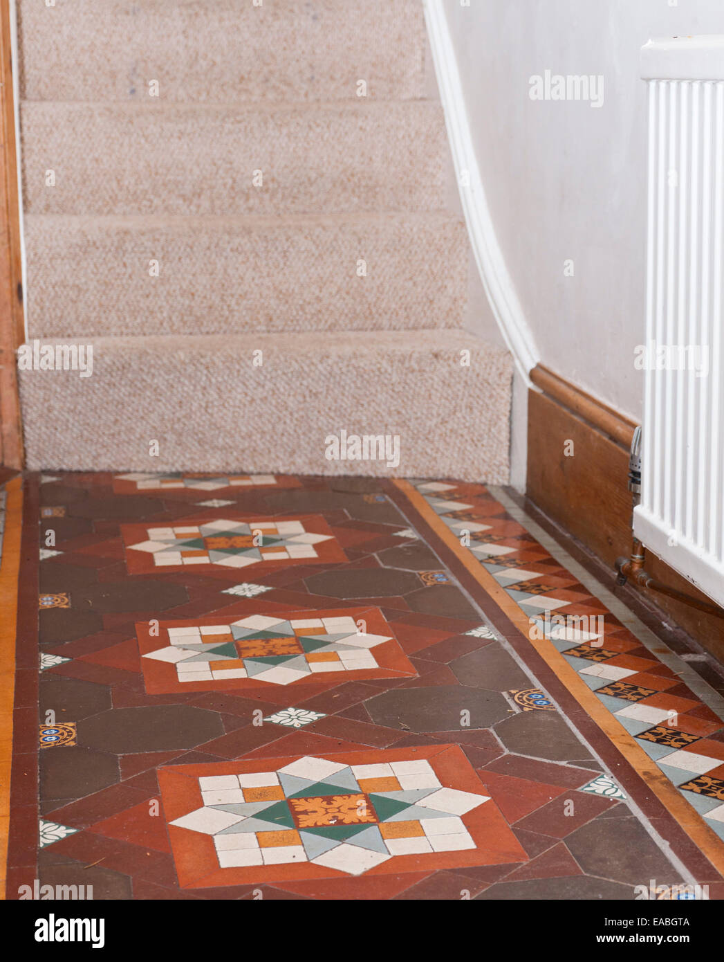 Hallway floor tiles in a Victorian terrace house. - Stock Image