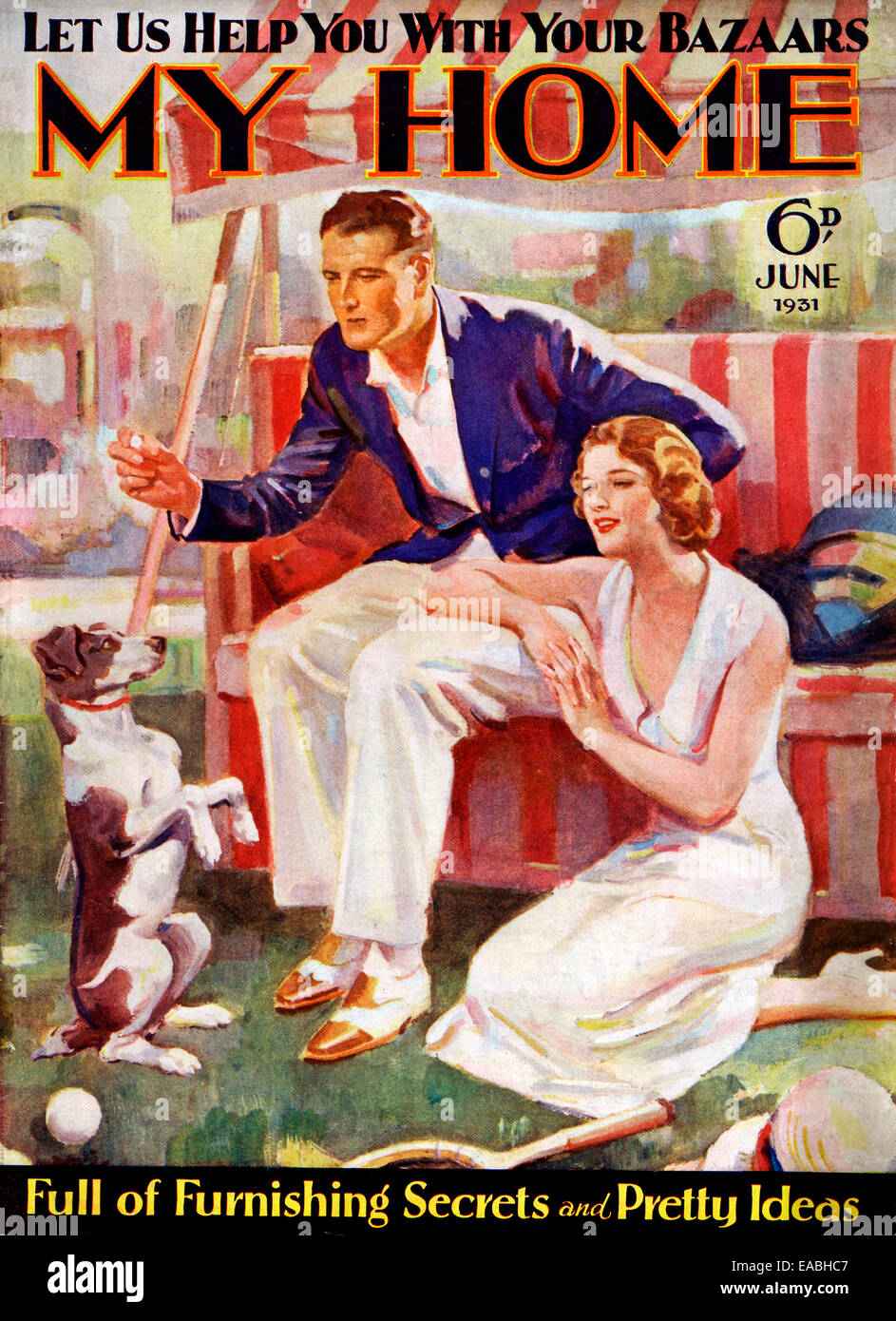My Home, Dog, 1931 cover of the English home and lifestyle magazine for the new suburban middle class, playing with - Stock Image